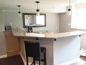 Basement kitchen and bar remodel with granite countertops in Rochester, Minnesota