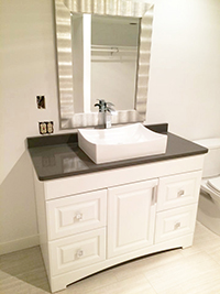 Close up of newly remodeled master bathroom vanity with vessel sink and quartz countertop in Rochester, MN