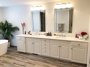 Master bathroom remodel showing beautiful grey vanity and white quartz countertop