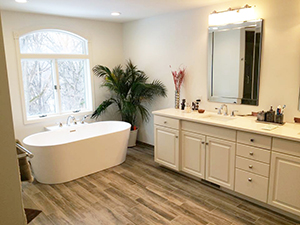 Master bathroom remodel with beautiful freestanding tub and vanity in Rochester, MN