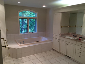 Master bath with old ugly white tiles before remodel was complete