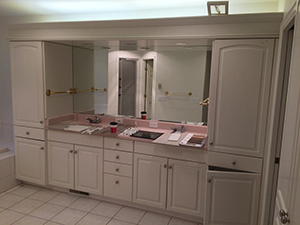 Master bath with old ugly white cabinets and pink countertop before remodel