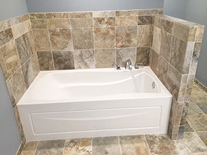 New bathtub with multi-color tile work in Rochester, Minnesota